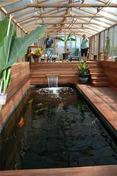 indoor koi fish pond design with wooden material | tapja.com