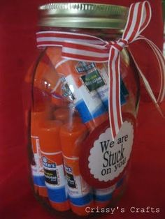 Beginning of year gift idea with glue sticks (A said that Mrs.G always needed glue sticks more than anything else all year long...he actually said at times it seemed as though she almost had too many crayons and other supplies but never enough glue!  I think I bought her something like 48 extra ones this year!  What a great way to package them)