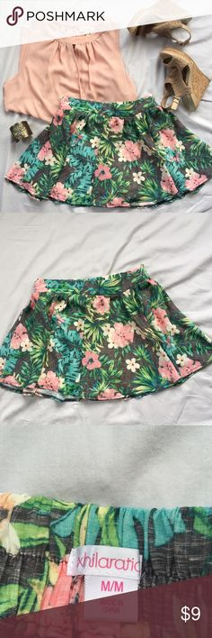 """Tropical Skater Skirt Full & Fun Size M Tropical Skater Skirt Size Medium.  This is a fun little skirt with built-in shorts!  Tropical pattern in peachy pink, green, gray & blue!  Skirt is a size medium with a 28"""" elastic waist (on the back waistline) and is about 15"""" in length.  Skirt by Xhiliration.  This skirt will be delivered to you gently steamed and beautifully wrapped in tissue. Xhilaration Skirts Mini"""