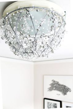 DIY Chandelier From a Hanging Plant Basket. Spruce up an old light fixture in just a few easy steps! All you need is a hanging wire plant basket, 4 - 6ft strings of decorative crystal garland, 3 metal hanging hooks and some Rust-Oleum Specialty Metallic Spray Paint. http://www.rustoleum.com/product-catalog/consumer-brands/specialty/metallic-spray/
