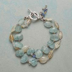 "ARCTIC BEAUTY BRACELET -- Glacial shades mingle in our double-strand bracelet handcrafted with aquamarine, rutilated quartz and a moment of kyanite. Thai silver toggle. Exclusive. 7-1/2""L."