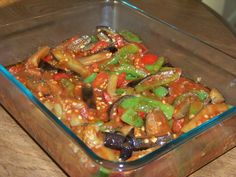 Eggplant and Peppers in Tomato Sauce Recipe Main Dishes with olive oil, garlic, eggplant, green bell pepper, red bell pepper, tomato sauce, salt, ground black pepper