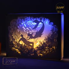 The Mermaid Paper Cut Light Box is a beautiful, unique gift for all ages. It is made from several layers of cut paper which are carefully arranged in a shadow box, lit from behind with flexible LED strips, in shades of blue, purple and white. Shadow Box Kunst, Shadow Box Art, Nursery Lighting, Baby Room Lighting, 3d Paper Art, Paper Crafts, Paper Cutting, Cut Paper, Underwater Lights