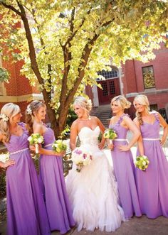 Cute picture of bride and bridesmaids wearing long lavender dresses!