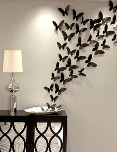 Fetco Rowhouse Butterfly Burst Wall Decor Cool Idea the way they left a plate with a few on it!