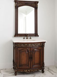 The 36″ Provincial Petite Single Bathroom Vanity is a handsome centerpiece for small bathrooms with big design goals. The solid mahogany frame features intricate carving, giving this piece depth and an eye-catching appeal. The Ivory Cream marble countertop and backsplash provide a lovely contrast against the dark finish and is installed with a Balsa porcelain sink. A double door cabinet also provides room for all the essentials. $2,681.00.