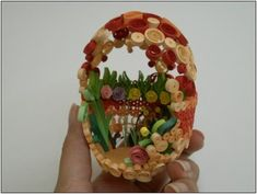 Quilled egg. Made from thin, rolled paper strips. I've made a few of these.