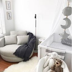 Gender neutral nurseries can still be stylish, like this one in different shades of grey and white, and you can always add more colour later How comfortable would nightly feeds and cuddles be in that huge chaise chair!