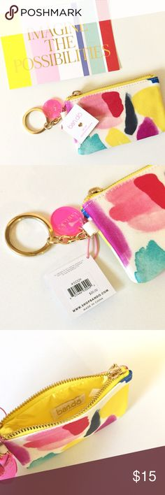 Bando Wristlet Details: NWT. Ban.do paint splatter wristlet. Retail $20. Zipper closure. Keychain feature.   Kate Harrington Boutique does not trade or negotiate price in the comment section. However, for most items we may consider reasonable offers.   Happy Poshing! ban.do Bags Clutches & Wristlets