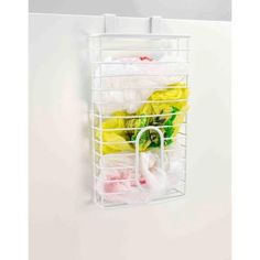 Keep all your plastic bags in one place and close at hand with this bag holder. Made from vinyl coated steel. Fits over most standard sized cabinets. Holds a lot of bags in one place. Super space saving features. Looks great in any kitchen setting. Color: White. Declutter Your Home, Organizing Your Home, Linen Closet Organization, Storage Organization, Door Mounted Spice Rack, Kitchen Pantry Storage, Diy Kitchen, Kitchen Design, Grocery Bag Holder