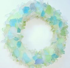 Seaside Decor Boutique    is excited to offer this colorful artisan handcrafted Pastel Beach Glass Wreath  that is an absolutely beautiful piece of artwork. This will add a special coastal style  to any beach decor . It can be used to add some color to a wall or as a centerpiece decoration on a table with a candle placed in the center.          Each wreath  is a one of a kind item as they are made to order. For indoor use only. The beach glass&