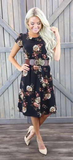 This black floral dress looks great on all body shapes. The Cassie has cap sleeves and is gathered at the waist. Would look great with a belt. 100% Polyester H