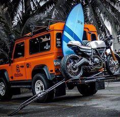 Land Rover Defender 90 w/ a bike & surfboard