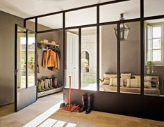 love the wall between the mudroom and the living spaces, how wonderful and light