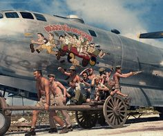 Captain Walter �Waddy� Young and his crew pose in front of their caricatures on their B-29 Superfortress, Nov. 24, 1944. | 20 Historic Photos Shown In Extraordinary Color