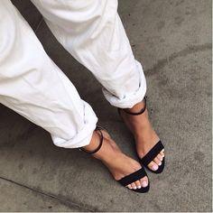 white pant, black sandals