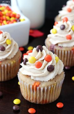 Triple Peanut Butter Cupcakes - peanut butter cupcake filled with mini reese's pieces and peanut butter chips, topped with peanut butter icing