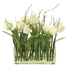 """Faux white tulips in a clear glass vase.  Product: Faux floral arrangementConstruction Material: Polyester, plastic, and glassColor: WhiteDimensions: 12"""" H x 14"""" W x 14"""" DCleaning and Care: Dust with dry cloth"""