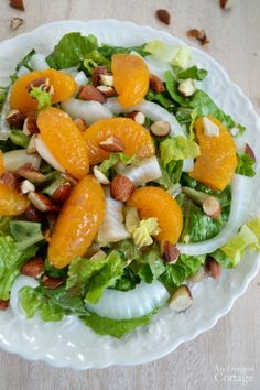 Orange Almond Salad - top greens with sweet onions, mandarin oranges, crunchy almonds and drizzle it all with an orange balsamic dressing for a quick and refreshing dinner salad.