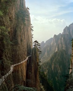 Huangshan mountain (Yellow Mountain), China. is a mountain range in southern Anhui province in eastern China. The range is composed of material that was uplifted from an ancient sea during the Mesozoic era, 100 million years ago. The mountains themselves were carved by glaciers during the Quaternary. Vegetation on the range is thickest below 1,100 meters (3,600 ft), with trees growing up to the treeline at 1,800 meters (5,900 ft).