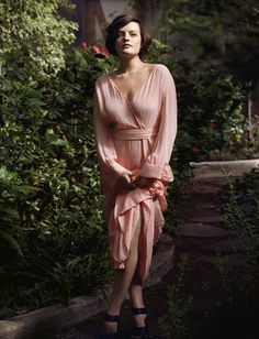 Elisabeth Moss in the Style Section of The NY Times.... In Louis Vuitton dress, price on request, and shoes, $1,450...  I request this!!!