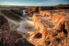 7. Grand Falls - Located just outside of Leupp on the Navajo Nation, this seasonal waterfall flows with chocolate-colored waters. Plan your trip accordingly because they only run after the winter snow melts or following heavy rainfall. Additionally, a permit is not required to visit and hike Grand Falls.