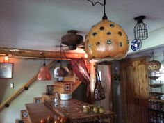 Gourd hanging lamp lights by Cathy Nyman
