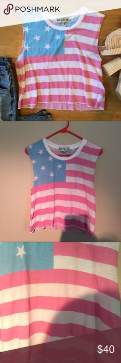 """Wildfox American Flag Muscle Crop Cropped top with faded flag print. Light weathered blue, white and very light weathered red that looks more like pink in person. Supposed to look worn and weathered. White spots supposed to be in red stripes. Scoop neck. Muscle style tank. Worn once and in great condition. Approximately 14"""" across the bust when laid flat and 18 1/2"""" from shoulder to hem. 50% cotton, 50% polyester Wildfox Tops Crop Tops"""
