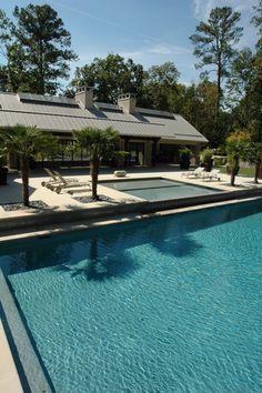 Two tiered pool and limestone terrace for a contemporary cabana by Howard Design Studio.