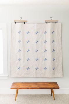 A modern take on a classic Amish quilt design, this minimal throw-size quilt features cornflower blue triangles, arranged in a pretty and graphic pattern. As part of Salty Oat's mission to support Ame