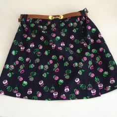 Topshop belted mini skirt size US 6 Very brit look/Alexa Chung Topshop blue mini skirt with floral pattern. Comes with a brown belt with gold buckle detail. US size 6. Great fit. Worn once or twice. Really good used condition. Topshop Skirts Mini