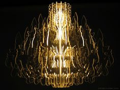 """Made from 16 transparent contours illuminated by a fluorescent bulb, this chandelier provides a modern reincarnation of the traditional chandelier. Through the use of special materials and accurate CNC milling techniques the whole body of this fixture emits a magic light. Together with table lamp """"Marie-Louise"""" and floor lamp """"Josephine"""" this sophisticated design is part of a series of unique lighting fixtures, which are guaranteed eye catchers in any interior.This may be purchased on…"""