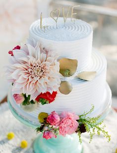 Dahlia wedding cake decor. Mint, gold with coral and pink accents