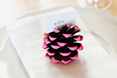 Transform pine cones into pretty place card holders with this tutorial.