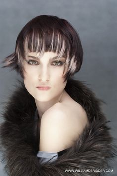 Blond triangular sections are taken in the fringe are giving a light beam in the face and sets off the deep brown color