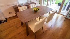 White Dining Chairs and Wood Veneer Extending Dining Table
