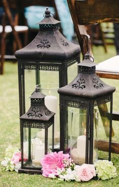 Pool decor - large and medium size silver lanterns with pillar candles and cut succulents (CP NOTE: Sans flowers, would look great at ceremony site and then moved to pool area) Lanterns Decor, Candle Lanterns, Candle Vases, Silver Lanterns, Large Lanterns, Rustic Lanterns, Hanging Lanterns, Glass Candle, Pillar Candles