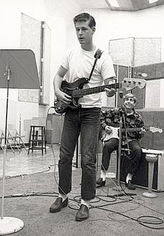 A very young Brian Wilson, foreground, with equally young David Marks behind him, in the studio, early '60s.