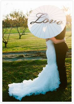 """LOVE this """"love"""" printed parasol photo with the bride & groom."""