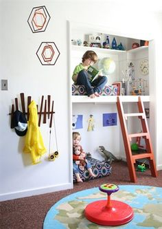 Bedroom closet turned into multi-level reading nook / playing nook. Shallow shelving allows for extra toy or book storage options. Painting with magnetic chalkboard paint also would allow for art display without using tape or making holes