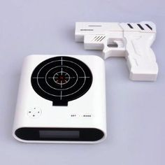 $9.27 Target Alarm Clock | Cool People Shop Target Alarm Clock requires a shot to hit the bullseye to shut it up. This clock solve the problem of people not getting out of bed.  By creating something with a loud noise that doesn't have a regular snooze button, the aim is to force you to get of bed and accomplish a task. This laser target alarm clock certainly achieves that as high accuracy is needed just as you wake to keep the thing quiet.