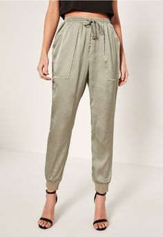 we've been lusting over these sage green satin joggers with pocket detail.