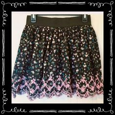 Forever 21 floral skirt Floral skirt with black background. Colors are pink, blue, and green. Pink crochet/embroidered edge, Forever 21 size large. 17 inches long from top of waistband.  14 inches across waistband. Stretches to 19 inches.  #floralskirt #flowerskirt #circleskirt #skaterskirt Forever 21 Skirts Circle & Skater