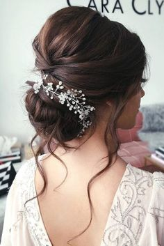 bridal hair accessories to inspire hairstyle elegant low bun with loose curls an. - - bridal hair accessories to inspire hairstyle elegant low bun with loose curls and white flowers and crystals caraclyne bridal Low Bun Wedding Hair, Bridal Hair Buns, Indian Bridal Hairstyles, Indian Wedding Hairstyles, Elegant Hairstyles, Wedding Hair And Makeup, Bride Hairstyles, Bridal Hair Updo Loose, Brown Wedding Hair