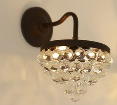 Callia Crystal Sconce | Pottery Barn I really love this as a contradiction to the subway tile and restored wood