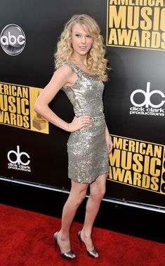 Taylor Swift Cocktail Dress - Taylor Swift sparkled in a silver sequined cocktail dress, which she paired with pewter accessories.