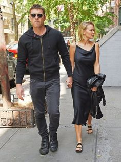 Lara Bingle Photos - Couple Sam Worthington and Lara Bingle seen arriving at their hotel in New York City, New York on September 20, 2014. Rumors are swirling that the couple is expecting their first child together and it looks like Lara is trying to hide her stomach behind a black leather jacket. - Are Sam Worthington