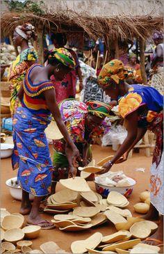 Togo women at wooden bowl stall at Friday Market by Craig Pershouse