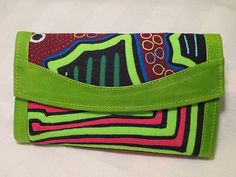 his is a beautiful wallet handmade in Colombia using high quality leather and colorful Mola fabrics sourced from indigenous artisans. Made by the Kuna Indians of northern Colombia, the Mola is a textile art form unique to them and their textiles are incorporated into a variety of wearable art such as shoes, wallets, and purses. These products are made by a family run fair-trade business in Colombia.  hnhlatinmarket.com