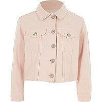 Pink denim Front flap patch pockets Distressed detailing Frayed edge hem Button-up front